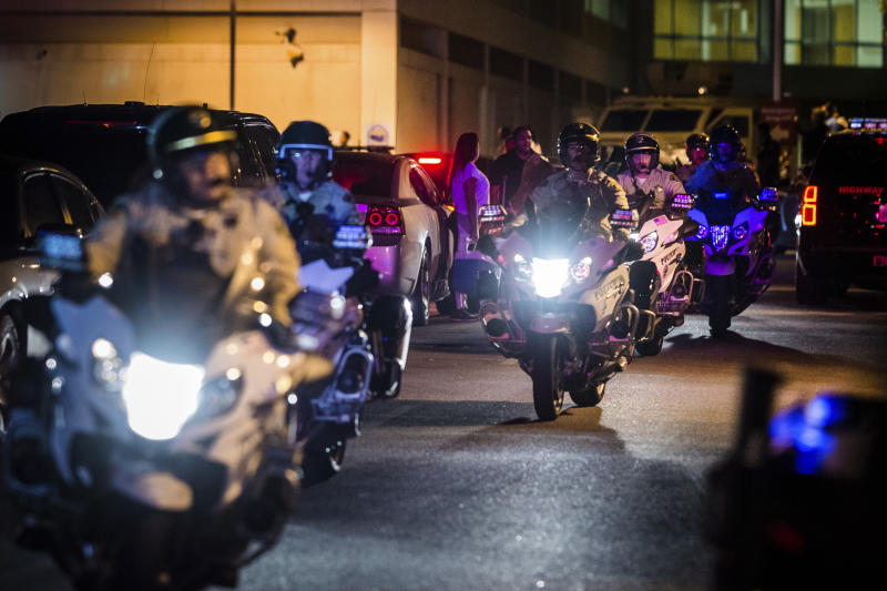 Motorcycle police officers escort the procession for fallen California Highway Patrol Officer Andre Moye at Riverside University Health System Medical Center in Moreno Valley on Monday, Aug 12, 2019. Moye was killed during a shootout following a traffic stop in Riverside. (Watchara Phomicinda/The Orange County Register via AP)