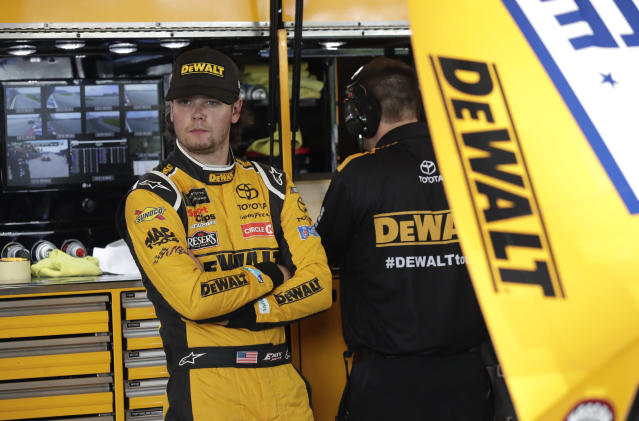 Erik Jones looks around from his garage during a practice session for the NASCAR Cup Series auto race at Chicagoland Speedway in Joliet, Ill., Saturday, June 30, 2018. (AP Photo/Nam Y. Huh)