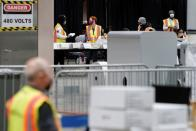 Electoral workers count postal ballots following the 2020 U.S. presidential election, in Philadelphia
