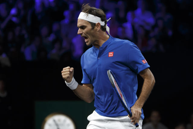 Team Europe's Roger Federer celebrates after winning a point against Team World's Nick Kyrgios during their match at the Laver Cup tennis event in Geneva, Switzerland, Saturday, Sept. 21, 2019. (Salvatore Di Nolfi/Keystone via AP)