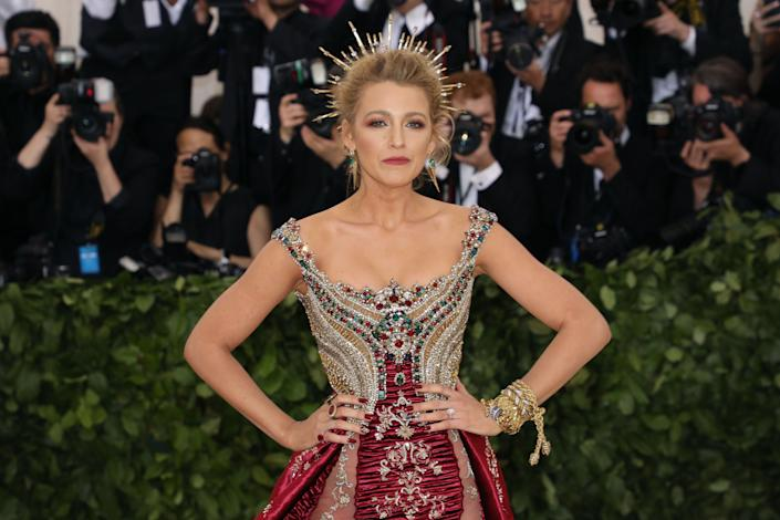 "Blake Lively wore <a href=""https://www.eonline.com/news/933414/blake-lively-s-chrome-met-gala-nails-took-over-a-month-to-create"" rel=""nofollow noopener"" target=""_blank"" data-ylk=""slk:a set of Kiss press-on nails that took more than a month to customize"" class=""link rapid-noclick-resp"">a set of Kiss press-on nails that took more than a month to customize</a> at the 2018 Met Gala in New York. (Photo: Taylor Hill via Getty Images)"