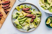 """You can make this excellent salad with any protein you'd like. The dressing, which has a bit of coconut and ginger, is the star—along with the creamy avocado. <a href=""""https://www.epicurious.com/recipes/food/views/skirt-steak-with-spicy-coconut-dressing?mbid=synd_yahoo_rss"""" rel=""""nofollow noopener"""" target=""""_blank"""" data-ylk=""""slk:See recipe."""" class=""""link rapid-noclick-resp"""">See recipe.</a>"""