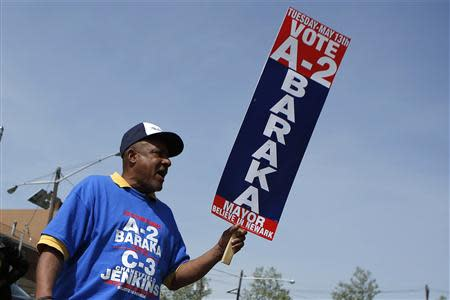 A supporter of Newark's mayoral candidate Baraka shouts slogans during mayoral elections in Newark, New Jersey