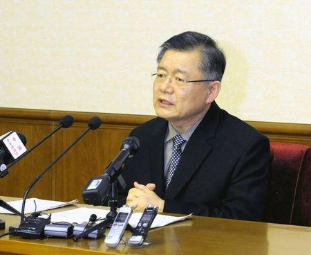 KCNA picture of Hyeon Soo Lim at a news conference at the People's Palace of Culture in Pyongyang