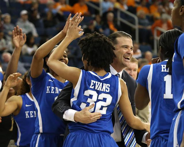 Kentucky coach Matthew Mitchell, center, celebrates with guard Kastine Evans (32) during a time-out of the second half of an NCAA college basketball game game against South Carolina in the semifinals of the Southeastern Conference women's basketball tournament, Saturday, March 8, 2014, in Duluth, Ga. Kentucky defeated South Carolina 68-58. (AP Photo/Jason Getz)