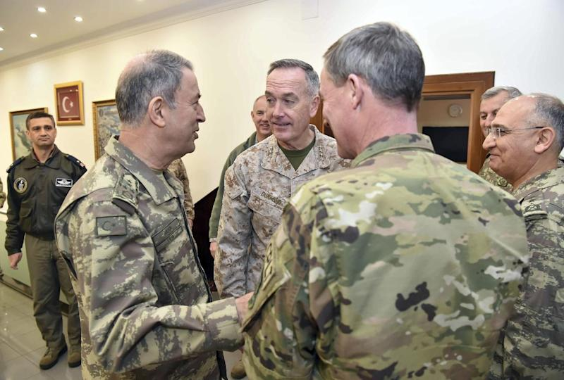 "The U.S. chairman of the Joint Chiefs of Staff, Gen. Joseph Dunford, rear centre, and Turkey's Chief of Staff Gen. Hulusi Akar, left, talk during a meeting in Incirlik Airbase in Adana, Turkey, Friday, Feb. 17, 2017.  Turkey's military says the Turkish and U.S. chiefs of staff have ""confirmed"" the need to fight terror groups in Syria and Iraq, including the Islamic State group and Kurdish militants.(Turkish Military, Pool Photo via AP)"