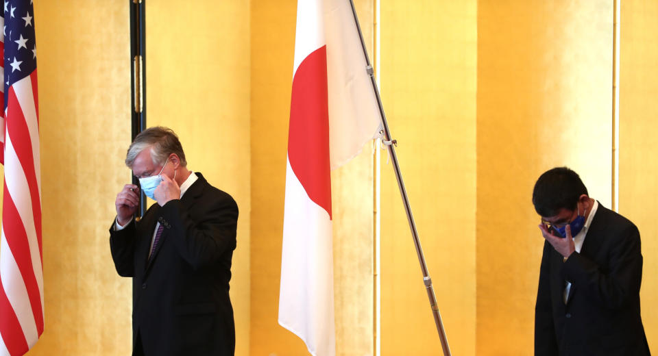 U.S. Deputy Secretary of State Stephen Biegun, left, the top U.S. official on North Korea, and Japan's Defense Minister Taro Kono, wearing face masks, arrive for a bilateral meeting in Tokyo Friday, July 10, 2020. (Behrouz Mehri/Pool Photo via AP)