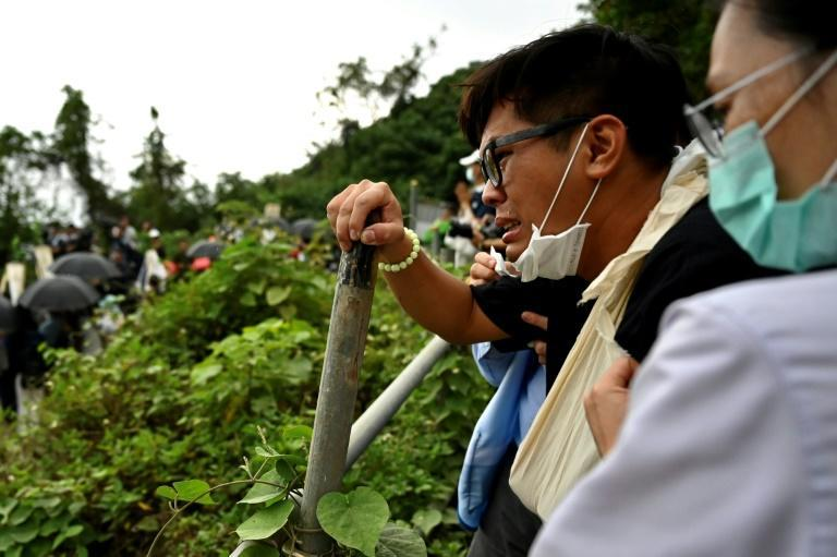 Relatives of the victims who died on the derailed train pray at the accident site on the mountains of Hualien after Taiwan's worst rail disaster in decades