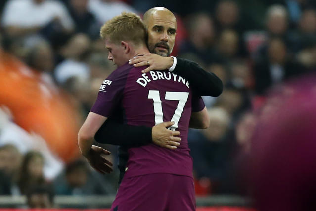 Pep Guardiola hugs Kevin De Bruyne during Manchester City's win over Tottenham. One day later, City clinched the Premier League title. (Getty)