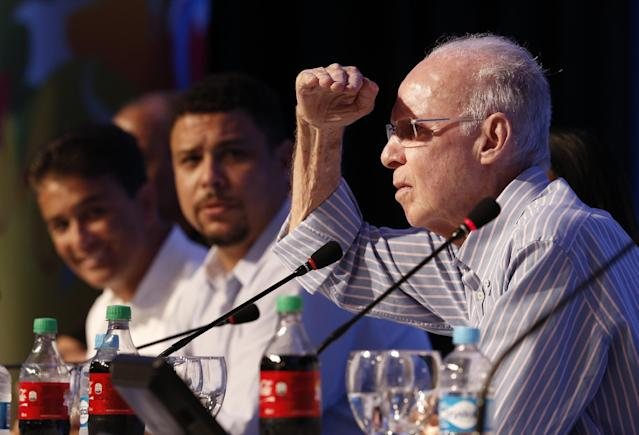 FIFA World Cup Ambassador Mario Zagallo, right, listens to a question, as Ronaldo, center, and Bebeto look on during a press conference in Costa do Sauipe, near Salvador, Brazil, Thursday, Dec.5, 2013. The draw for the 2014 World Cup finals takes place Friday, Dec. 6. (AP Photo/Silvia Izquierdo)