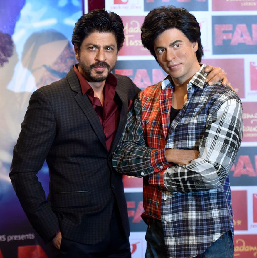 Bollywood actor Shah Rukh Khan poses with a waxwork model of himself at Madame Tussauds in London, Britain. (Image: Reuters)
