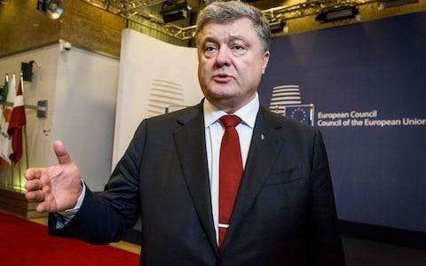 <span>Ukrainian President Petro Poroshenko addresses the media at the end of the EU Eastern Partnership Summit in Brussels on November 24.</span> <span>Credit: Aurore Belot/AFP/Getty Images </span>