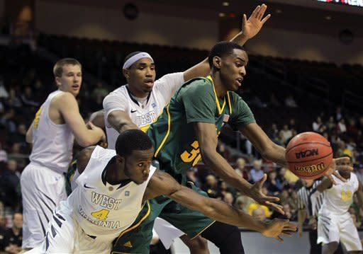 Baylor's Quincy Miller, center, scrambles for a loose ball against West Virginia's Jabarie Hinds, rear, and Kevin Jones (4) in the second half of an NCAA college basketball game, Friday, Dec. 23, 2011, in Las Vegas. Baylor won 83-81 in overtime. (AP Photo/Julie Jacobson)