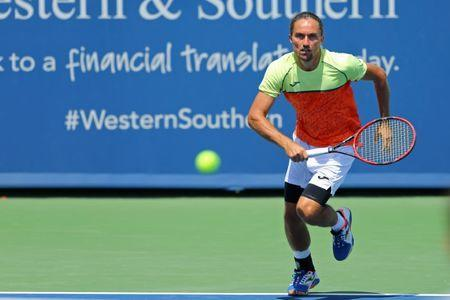 Aug 12, 2017; Mason, OH, USA; Alexandr Dolgopolov (UKR) charges the net against Reilly Opelka (USA) during the Western and Southern Open at Lindner Family Tennis Center. Mandatory Credit: Aaron Doster-USA TODAY Sports