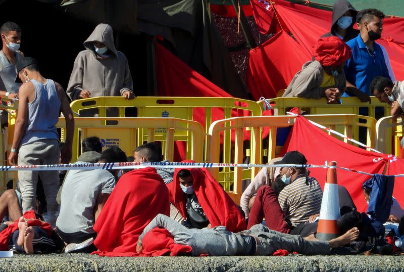 FILE PHOTO: Over two thousand migrants rest in the Arguineguin harbour, in the Spanish island of Gran Canaria
