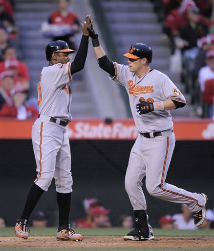 Baltimore Orioles' Matt Wieters, right, is congratulated by teammate Adam Jones after hitting a two-run home run during the fifth inning of their baseball game against the Los Angeles Angels, Saturday, April 21, 2012, in Anaheim, Calif. (AP Photo/Mark J. Terrill)