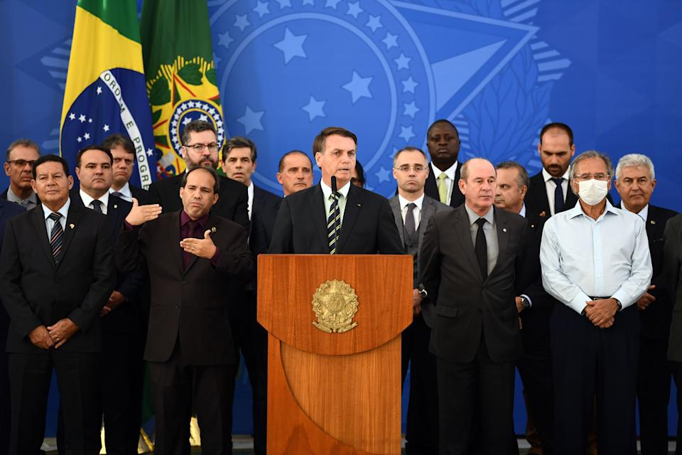 Brazil's President Jair Bolsonaro (C) delivers a press conference in Brasilia, Brazil, on April 24, 2020. - Brazilian Minister of Justice and Public Security, Sergio Moro, announce his resignation on Friday after Brazilian President Jair Bolsonaro dismissed the head of the Brazilian Federal Police, according to sources close to the popular former anti-corruption judge. (Photo by EVARISTO SA / AFP) (Photo by EVARISTO SA/AFP via Getty Images)