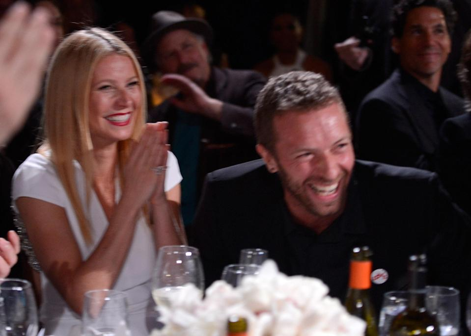 Gwyneth Paltrow and Chris Martin at the Sean Penn and Friends Help Haiti Home benefit in January 2014 — two months before they announced their split. (Photo: Getty Images)
