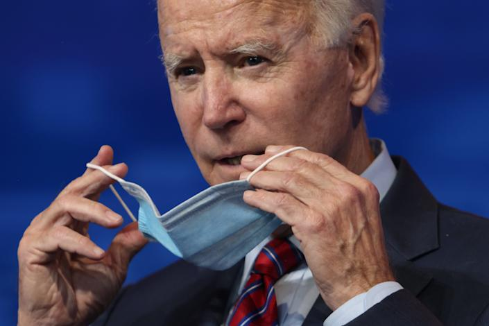 U.S. President-elect Joe Biden put on a mask after he spoke on November job numbers at the Queen theater December 4, 2020 Wilmington, Delaware. (Alex Wong/Getty Images)