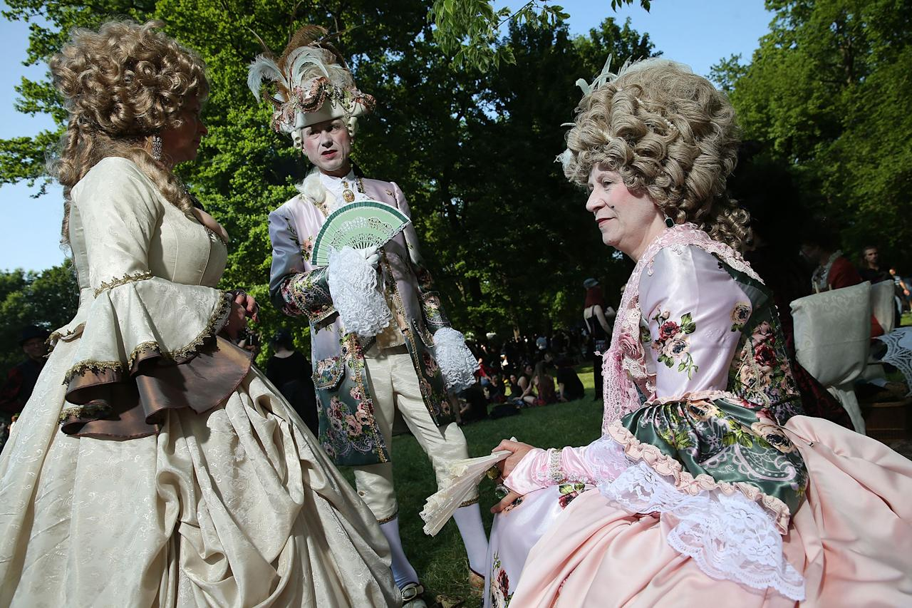 <p>Visitors in outfits inspired by 17th-century European royal courts attend the Victorian picnic on the first day of the annual Wave-Gotik-Treffen (WGT) Goth music festival on June 2, 2017 in Leipzig, Germany. (Sean Gallup/Getty Images) </p>