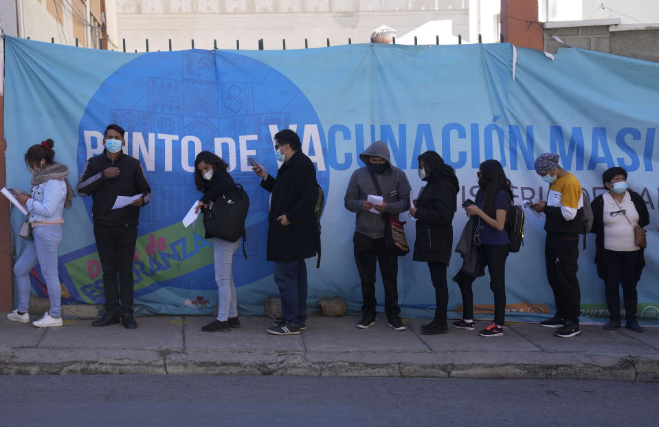 People line up for shot of the Sinopharm COVID-19 vaccine during a vaccination campaign for people over 18 in La Paz, Bolivia, Monday, July 12, 2021. (AP Photo/Juan Karita)