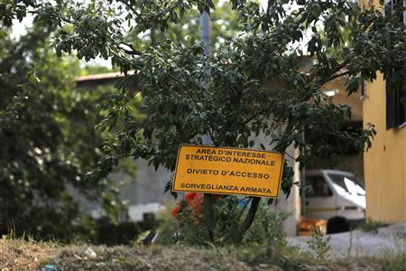 "A sign which reads, ""Prohibited to enter. Under close weapon surveillance"" at an orchard confiscated from the Camorra clan, or the local mafia, in Chiaiano next to Scampia, district of northern Naples"