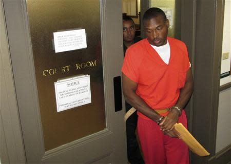 Convicted killer Aundra Akins leaves a courtroom in Monticello