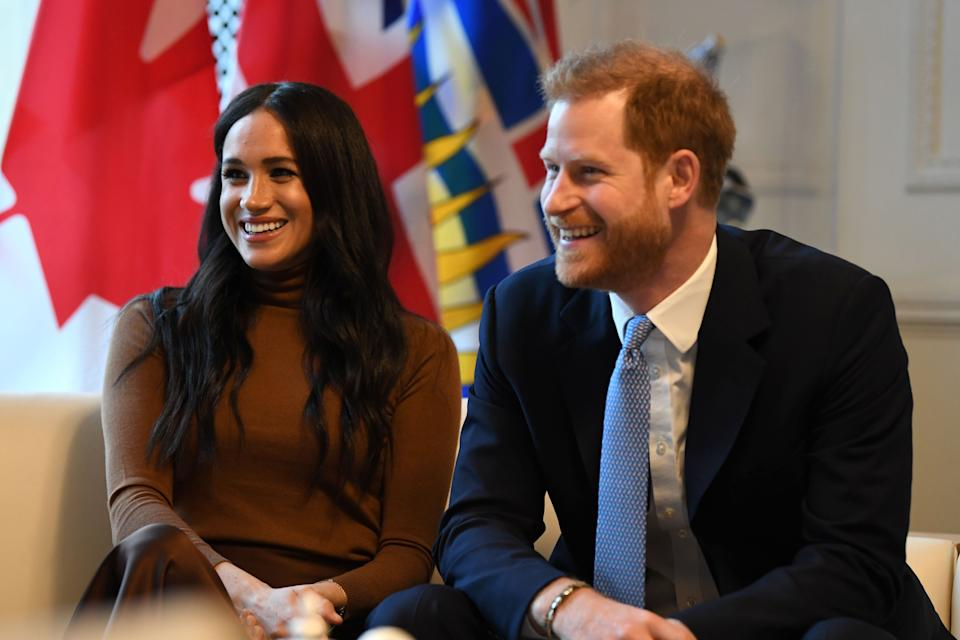 Britain's Prince Harry, Duke of Sussex and Meghan, Duchess of Sussex react during their visit to Canada House in thanks for the warm Canadian hospitality and support they received during their recent stay in Canada,  in London on January 7, 2020. (Photo by DANIEL LEAL-OLIVAS / POOL / AFP) (Photo by DANIEL LEAL-OLIVAS/POOL/AFP via Getty Images)
