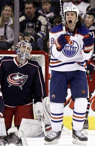 Edmonton Oilers' Ryan Jones, right, reacts to his goal as Columbus Blue Jackets goalie Steve Mason looks on in the second period of an NHL hockey game, Sunday, March 25, 2012, in Columbus, Ohio. (AP Photo/Paul Vernon)