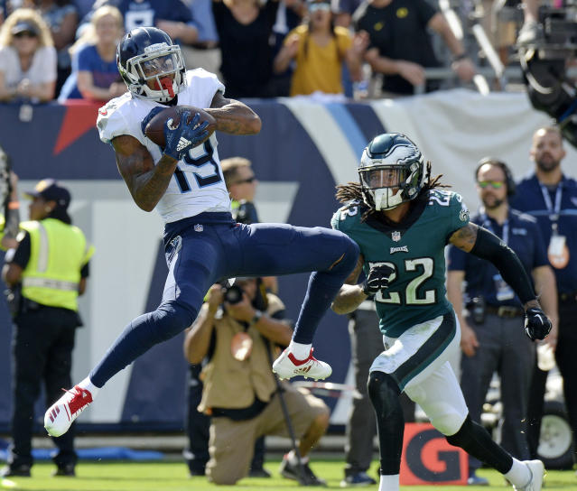 <p>Tennessee Titans wide receiver Tajae Sharpe (19) catches a touchdown pass in front of Philadelphia Eagles cornerback Sidney Jones (22) in the second half of an NFL football game Sunday, Sept. 30, 2018, in Nashville, Tenn. (AP Photo/Mark Zaleski) </p>