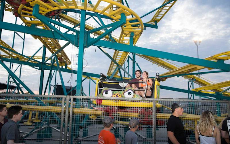 The fair offers rollercoasters, a ferris wheel, and every type of ride a thrillseeker could ask for. | Jason Bergman