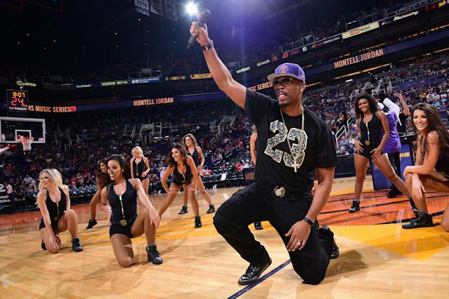 Musician Montell Jordan, seen here showing fans watching a Suns/Lakers game how he does it, is prepared to aid the Cavs in their time of need. (Getty)