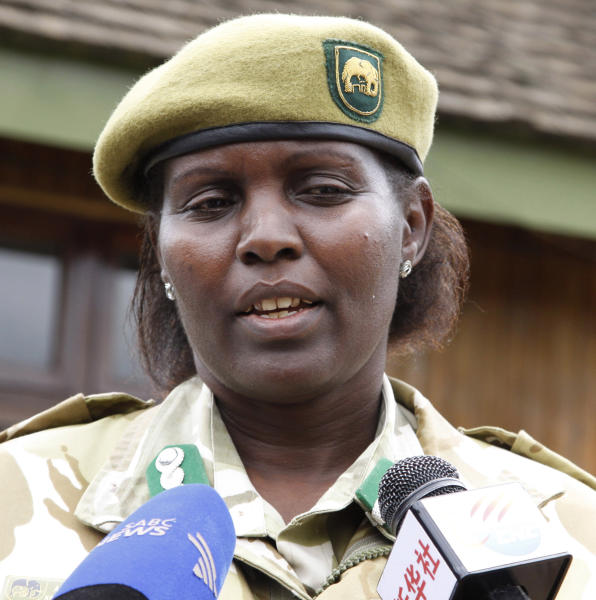Kenyan Wildlife Service assistant director Anne Kahihia speaks to journalists in Nairobi, Kenya, Wednesday, June 20 , 2012. The Kenya Wildlife Service says residents on the outskirts of Nairobi speared to death six lions after the carnivores killed four goats from their herd. KWS said Wednesday that two adult lionesses, two younger lions and two cubs were killed overnight by a mob wielding spears. The lions had strayed outside of Nairobi National Park in search of food when they killed the goats.(AP Photo/Khalil Senosi)