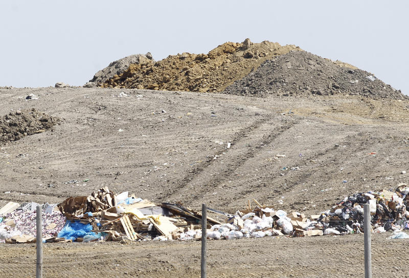 Law enforcement officials have called for all residential and commercial trash in the city of Evansdale to be set aside in the Black Hawk County landfill to be searched through by those involved in the ongoing investigation for missing Elizabeth Collins, 8, and her cousin Lyric Cook-Morrissey, 10, Wednesday, July 18, 2012, in Waterloo, Iowa. (AP Photo/Waterloo Courier, Matthew Putney)