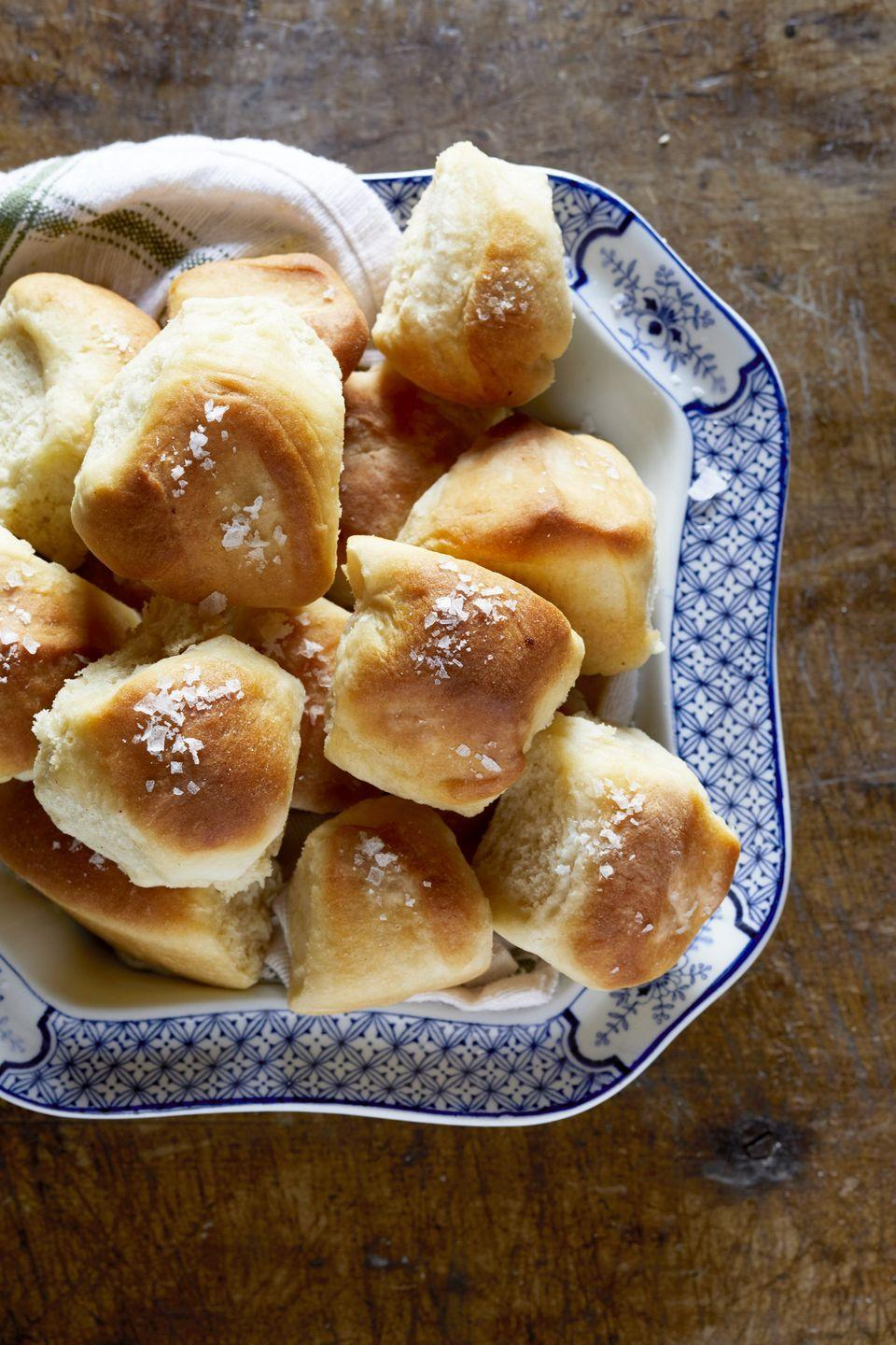"<p>Pass the rolls, please! In particular, these soft Parker House ones topped with a pinch of sea salt.</p><p><strong><a href=""https://www.countryliving.com/food-drinks/a29144926/nancy-fuller-parker-house-rolls/"" rel=""nofollow noopener"" target=""_blank"" data-ylk=""slk:Get the recipe"" class=""link rapid-noclick-resp"">Get the recipe</a>.</strong></p><p><strong><a class=""link rapid-noclick-resp"" href=""https://www.amazon.com/Cuisinart-AMB-9RCK-Classic-Nonstick-Bakeware/dp/B0000ULZX6/?tag=syn-yahoo-20&ascsubtag=%5Bartid%7C10050.g.896%5Bsrc%7Cyahoo-us"" rel=""nofollow noopener"" target=""_blank"" data-ylk=""slk:SHOP CAKE PANS"">SHOP CAKE PANS</a><br></strong></p>"