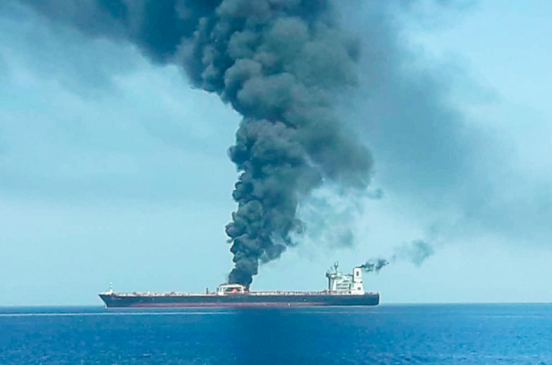 Huge plumes of smoke can be seen billowing from the tanker (Reuters)