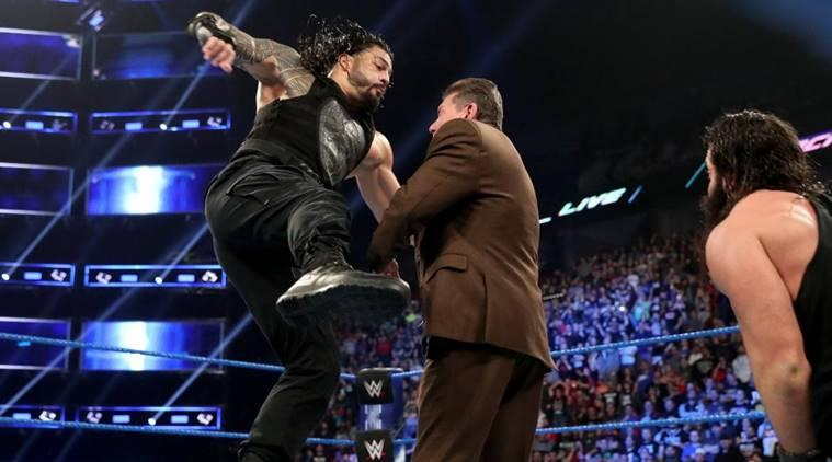 Roman Reigns, Vince McMahon and Elias on WWE SmackDown Live