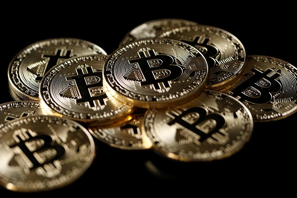 A collection of Bitcoin (virtual currency) tokens are displayed in this picture illustration taken December 8, 2017. REUTERS/Benoit Tessier/Illustration