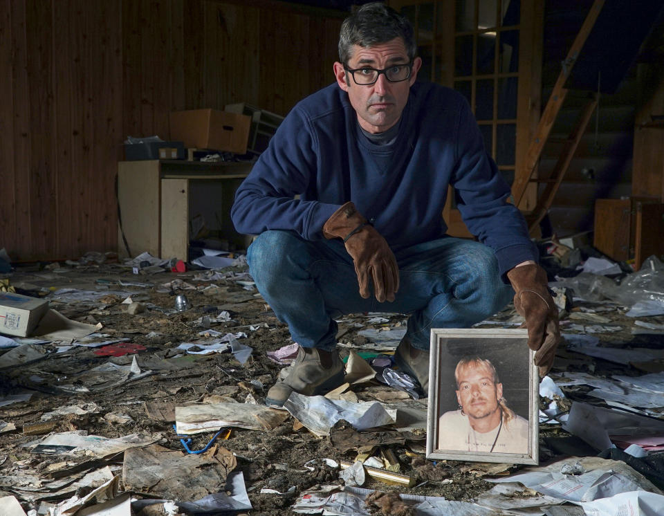 Louis holding a picture of a young Joe Exotic, at what remains of his home in Oklahoma (Jack Rampling / Mindhouse)