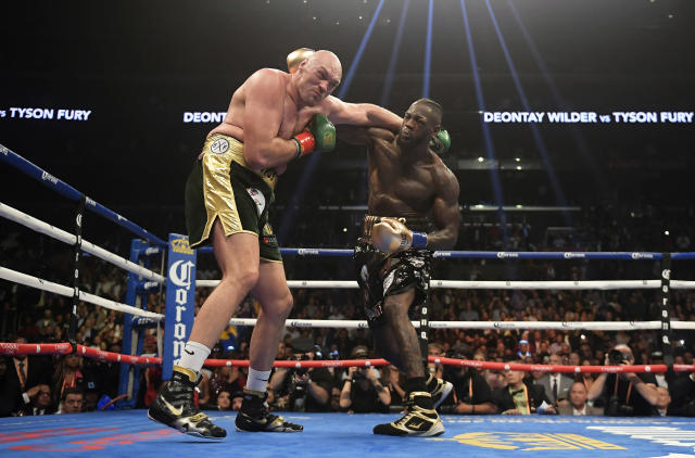 Deontay Wilder, right, connects with Tyson Fury, of England, during a WBC heavyweight championship boxing match, Saturday, Dec. 1, 2018, in Los Angeles. (AP Photo/Mark J. Terrill)