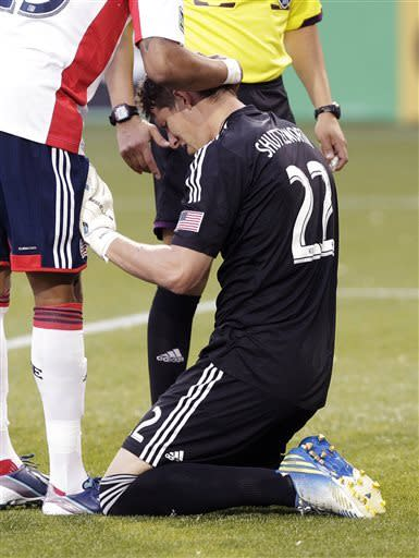 New England Revolution goalie Donovan Ricketts is checked over by a teammate after a collision with a Portland Timbers player during the first half of an MLS soccer match in Portland, Ore., Thursday, May 2, 2013. (AP Photo/Don Ryan)