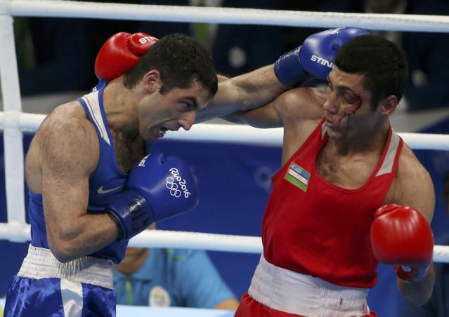 2016 Rio Olympics - Boxing - Final - Men's Fly (52kg) Final Bout 271 - Riocentro - Pavilion 6 - Rio de Janeiro, Brazil - 21/08/2016. Shakhobidin Zoirov (UZB) of Uzbekistan and Misha Aloian (RUS) of Russia compete. REUTERS/Matthew Childs FOR EDITORIAL USE ONLY. NOT FOR SALE FOR MARKETING OR ADVERTISING CAMPAIGNS.