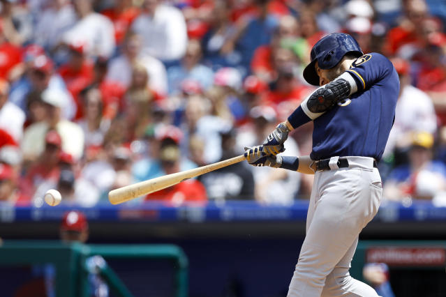 Milwaukee Brewers' Ryan Braun hits an RBI-single off Philadelphia Phillies starting pitcher Zach Eflin during the third inning of a baseball game, Thursday, May 16, 2019, in Philadelphia. (AP Photo/Matt Slocum)