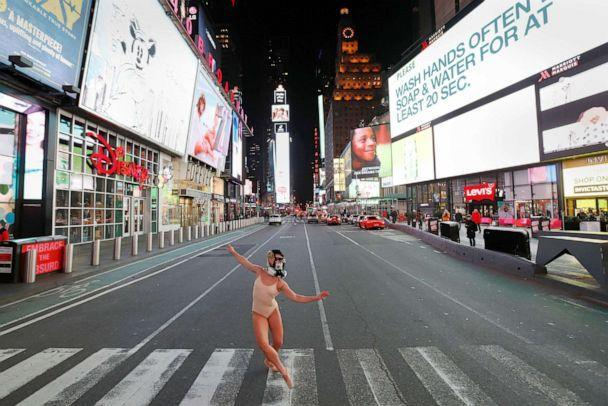 PHOTO: Ballet dancer and performer Ashlee Montague of New York wears a gas mask while she dances in Times Square as the coronavirus disease (COVID-19) outbreak continued in New York City, March 18, 2020. (Andrew Kelly/Reuters)