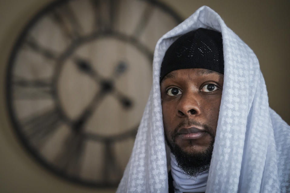 Myon Burrell is photographed at his home in Minneapolis, Thursday, Dec. 17, 2020, two days after his release from prison. Minnesota's pardon board on Tuesday commuted the sentence of Burrell, 34, who was sent to prison for life as a teen in a high-profile murder case that raised questions about the integrity of the criminal justice system. (AP Photo/John Minchillo)