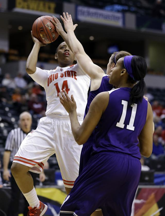 Ohio State guard Ameryst Alston, left, shoots over Northwestern Wildcats forward Lauren Douglas in the first half of an NCAA college basketball game in the opening round of the Big Ten Tournament in Indianapolis, Ind., Thursday, March 6, 2014. (AP Photo/Michael Conroy)