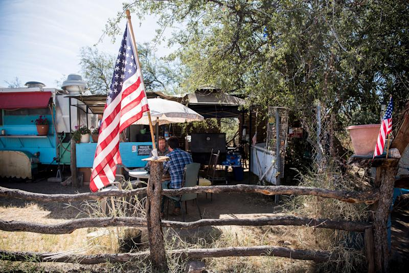 "An American flag sits in front of the ""La Rancherita"" restaurant in Arivaca, Arizona. Some residents of the small town want to do everything they can to help people who are crossing the border. But not everyone agrees with that effort."
