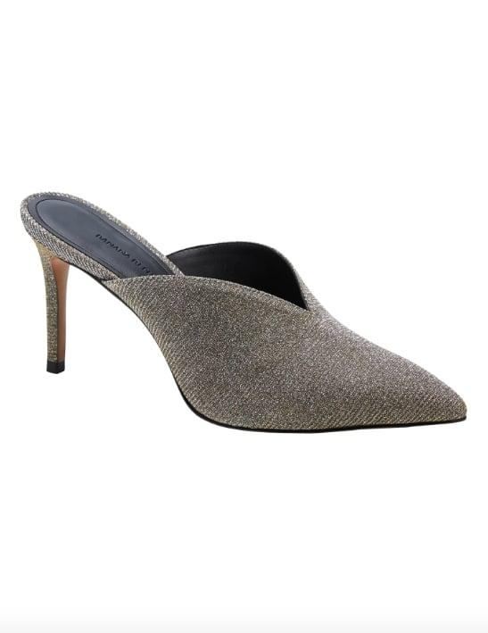 "<p>The great thing about a <a href=""https://www.popsugar.com/buy/Glitter-Mule-Pump-525473?p_name=Glitter%20Mule%20Pump&retailer=bananarepublic.gap.com&pid=525473&price=148&evar1=fab%3Aus&evar9=46963684&evar98=https%3A%2F%2Fwww.popsugar.com%2Ffashion%2Fphoto-gallery%2F46963684%2Fimage%2F46963703%2FGlitter-Mule-Pump&prop13=mobile&pdata=1"" rel=""nofollow"" data-shoppable-link=""1"" target=""_blank"" class=""ga-track"" data-ga-category=""Related"" data-ga-label=""http://bananarepublic.gap.com/browse/product.do?pid=514708002&amp;cid=1141562&amp;pcid=1093362&amp;vid=1&amp;grid=pds_31_71_1#pdp-page-content"" data-ga-action=""In-Line Links"">Glitter Mule Pump</a> ($148) is that it works year round. It also works just as well with jeans as it does a sexy slip dress. </p>"