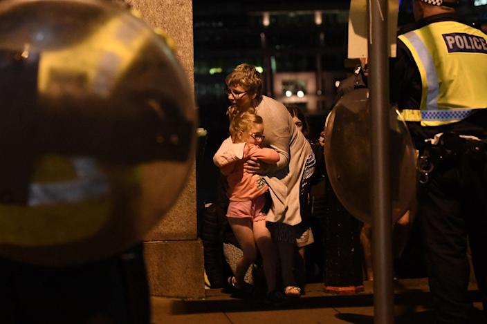 <p>People are lead to safety on Southwark Bridge away from London Bridge after an attack on June 4, 2017 in London, England. (Carl Court/Getty Images) </p>
