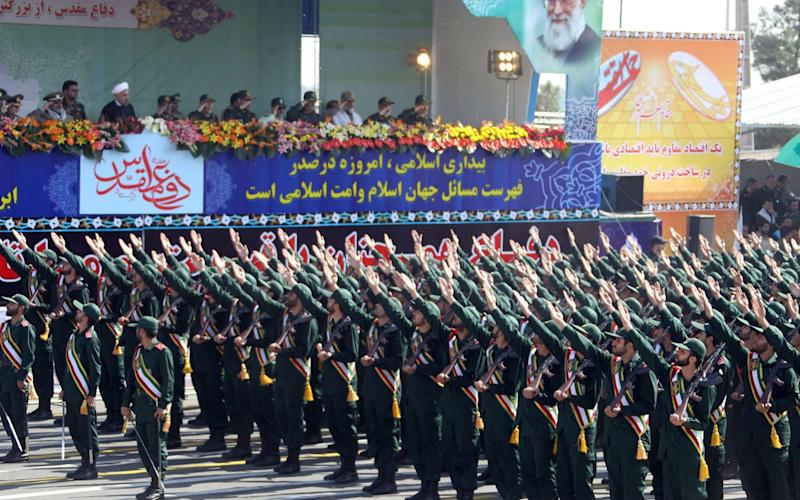 Members of Iran's elite Revolutionary Guards march through Tehran - AFP